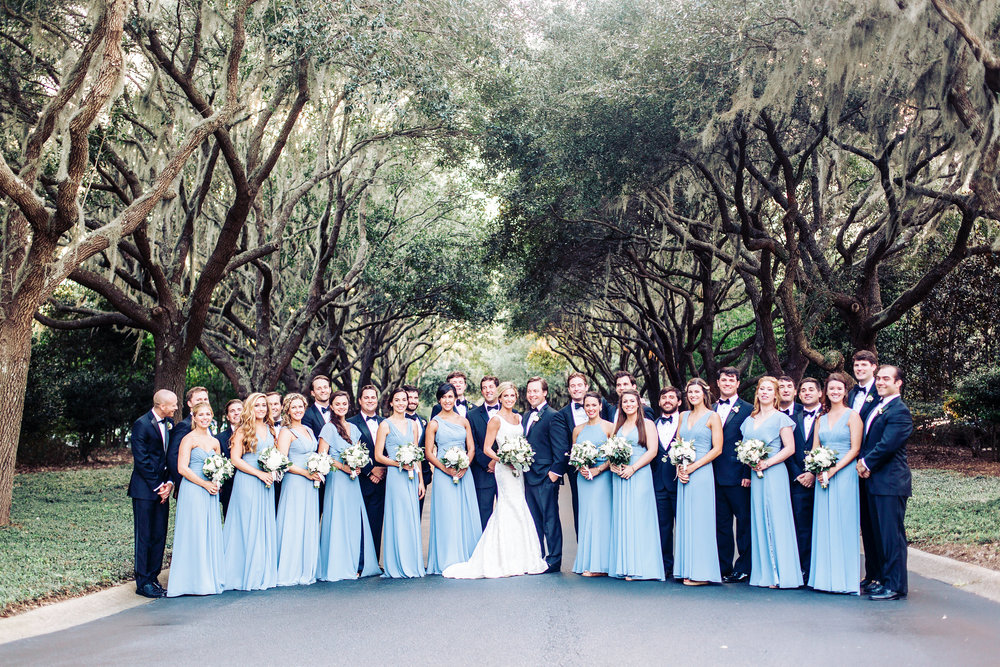 Bridesmaids wearing blue Monique Lhuillier floor length dresses at Lowcountry wedding in Georgetown, SC