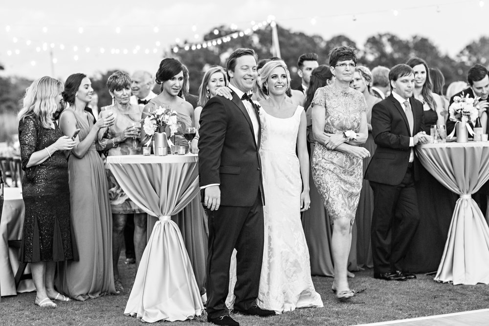 Candid wedding portraits at The DeBordieu Club  Greenery table runners on rustic farm tables with tall candles  //  A Lowcountry Wedding Magazine & Blog