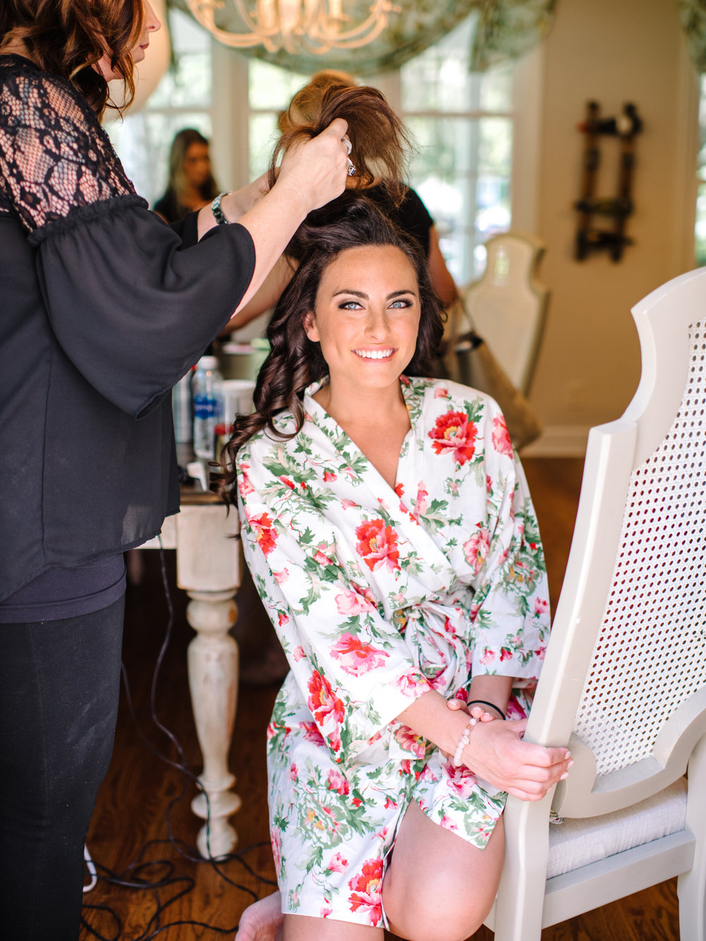 Myrtle Beach bride wearing floral robe for a wedding at Wachesaw Plantation