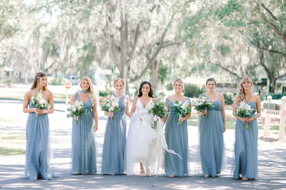 Myrtle Beach bride and her bridesmaids wearing long blue Jenny Yoo dresses
