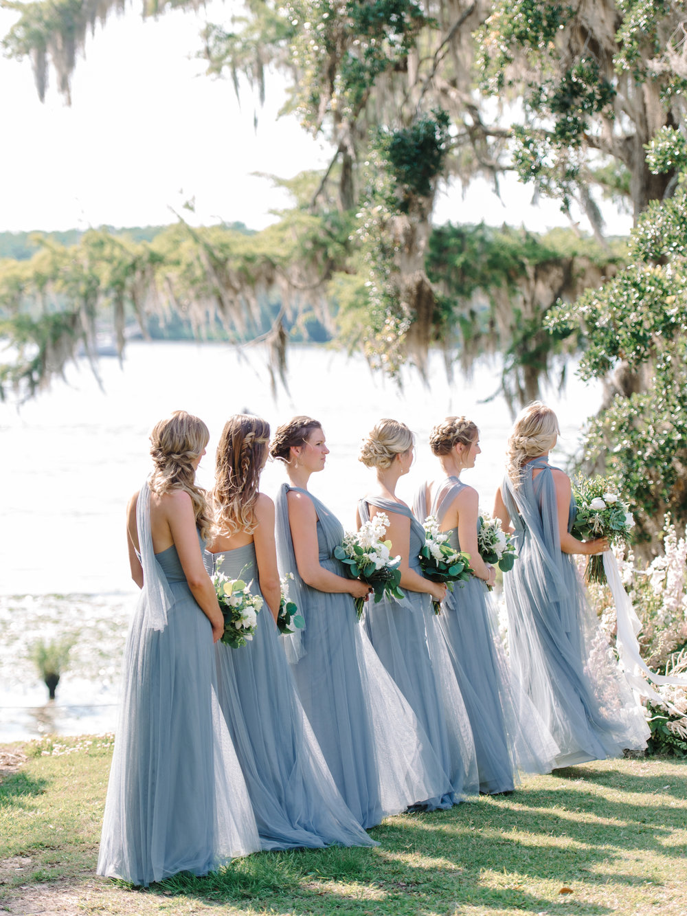 Bridesmaids wearing long blue Jenny Yoo dresses for Wachesaw Plantation wedding ceremony  //  A Lowcountry Wedding Magazine & Blog