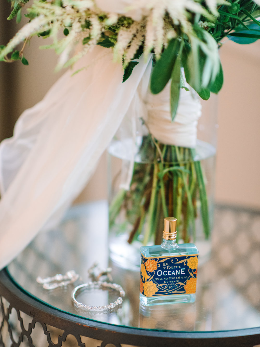 Myrtle Beach bride prepping for her with oceane perfume photographed by Pasha Belman Photography