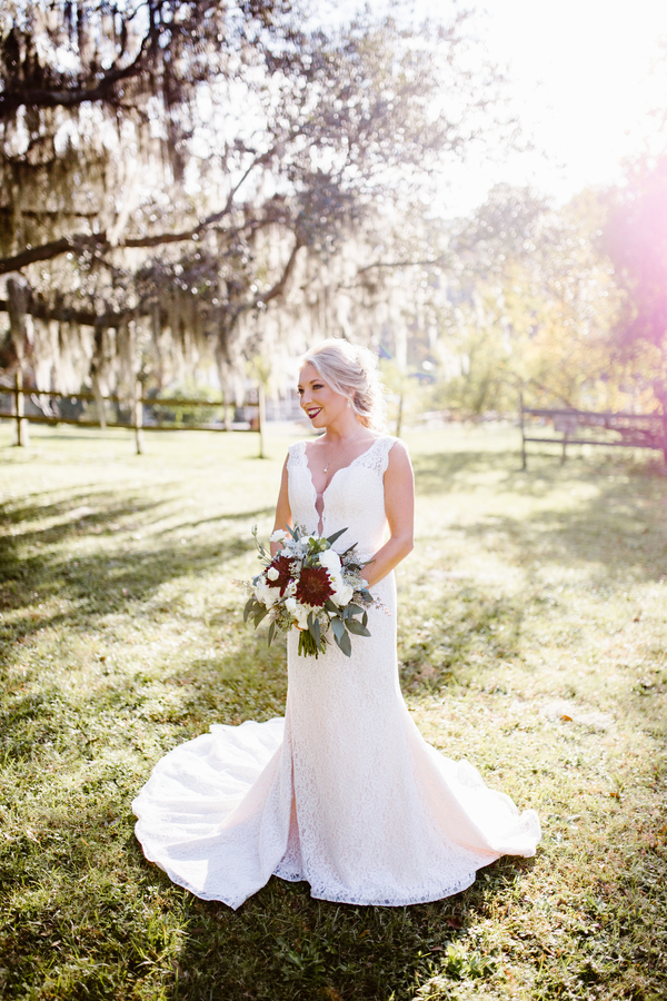 Savannah Bride in lace gown with red dahlia bouquet  //  A Lowcountry Wedding Magazine