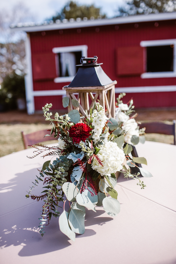 Outdoor reception decor with lanterns at Red Gate Farms wedding  //  A Lowcountry Wedding Magazine