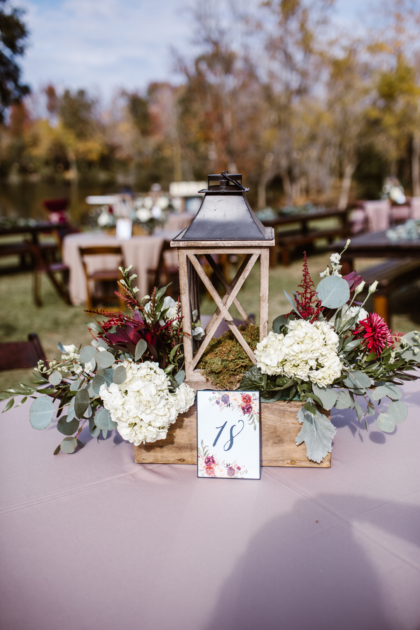 Rustic wedding decor with lanterns and farm tables at Red Gate Farms  //  A Lowcountry Wedding Magazine