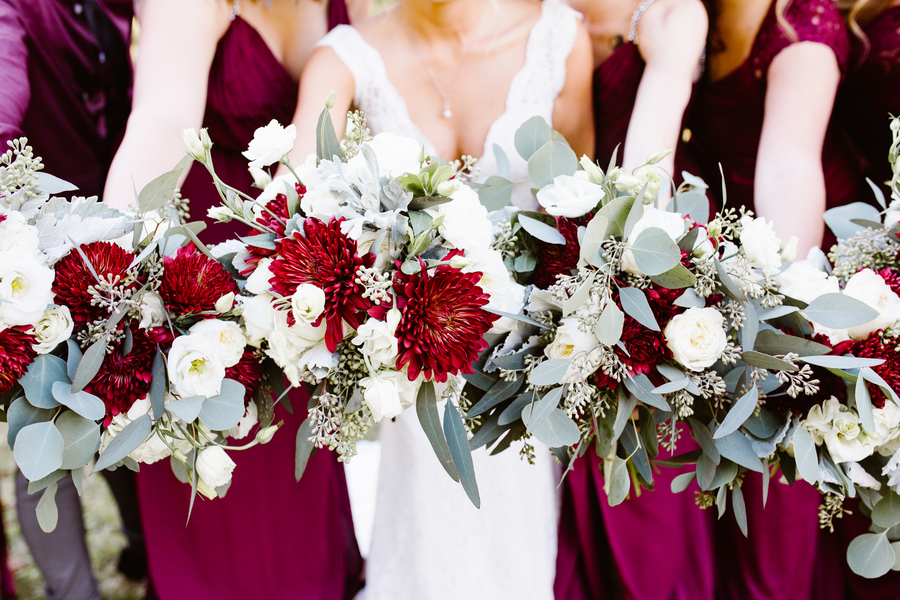 Bridesmaids in deep red with winter bouquets in Savannah GA  //  A Lowcountry Wedding Magazine