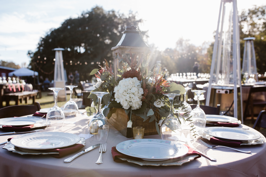 Rustic table decor with lanterns and farm tables at Red Gate Farms  //  A Lowcountry Wedding Magazine