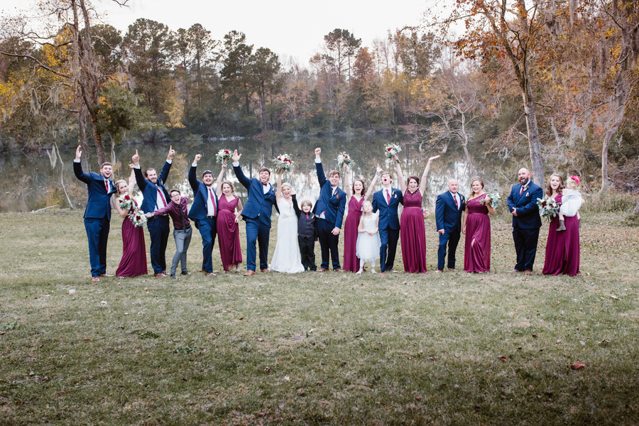 Bridal party at Red Gate Farms - bridesmaids wearing cranberry lace dresses and groomsmen in navy suits  //  A Lowcountry Wedding Magazine