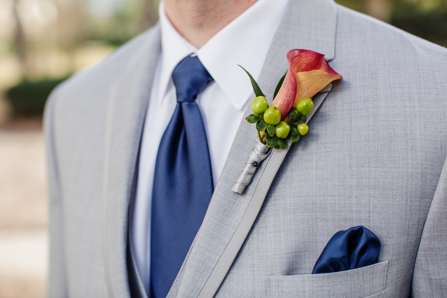 Groom wearing a grey suit, navy pocket square and calla lily boutonneire   //  A Lowcountry Wedding Magazine & Blog