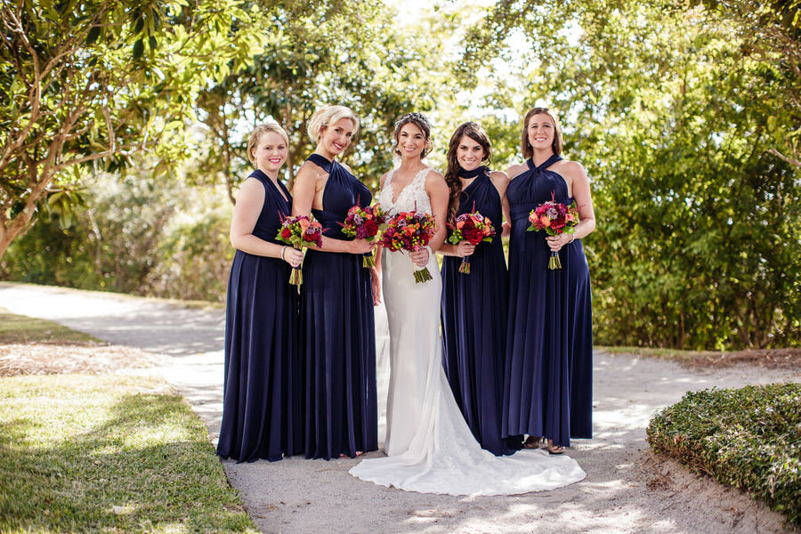 Charleston bridesmaids wearing long, floor length blue dresses at Harborside East  //  A Lowcountry Wedding Magazine & Blog