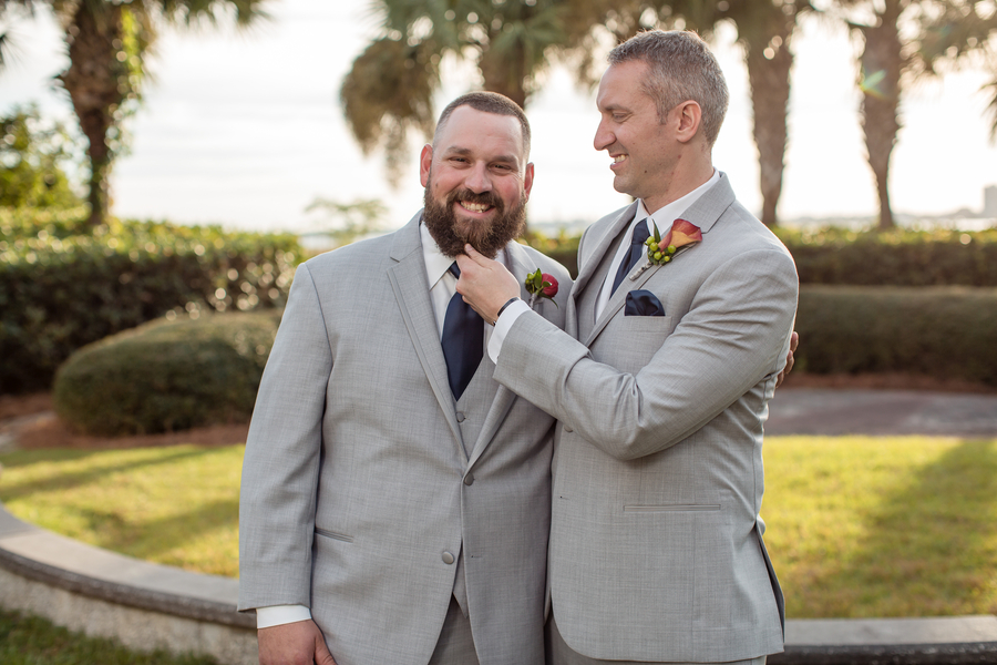 Groom and groomsman wearing grey suits and navy ties at Harborside East   //  A Lowcountry Wedding Magazine & Blog