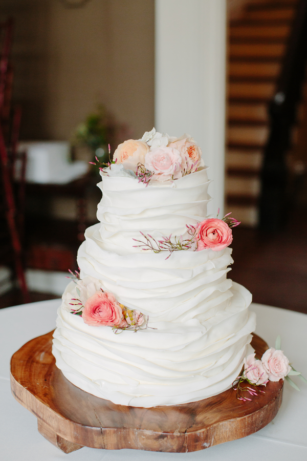 Three-tiered spring cake by Wildflour Pastry  //  Charleston wedding photography by Riverland Studios  //  A Lowcountry Wedding Magazine