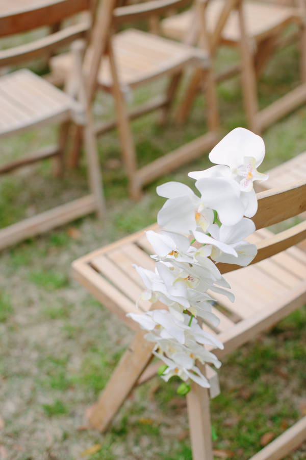 Orchid pew markers for outdoor Jewish wedding ceremony at The Wickliffe House
