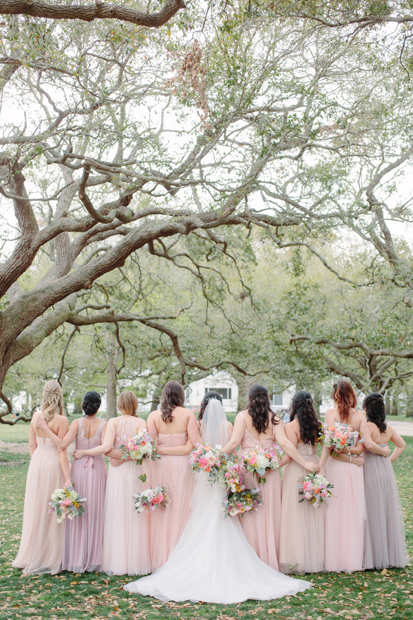 Bridesmaids in long pastel dresses, photography by Riverland Studios  //  A Lowcountry Wedding Magazine