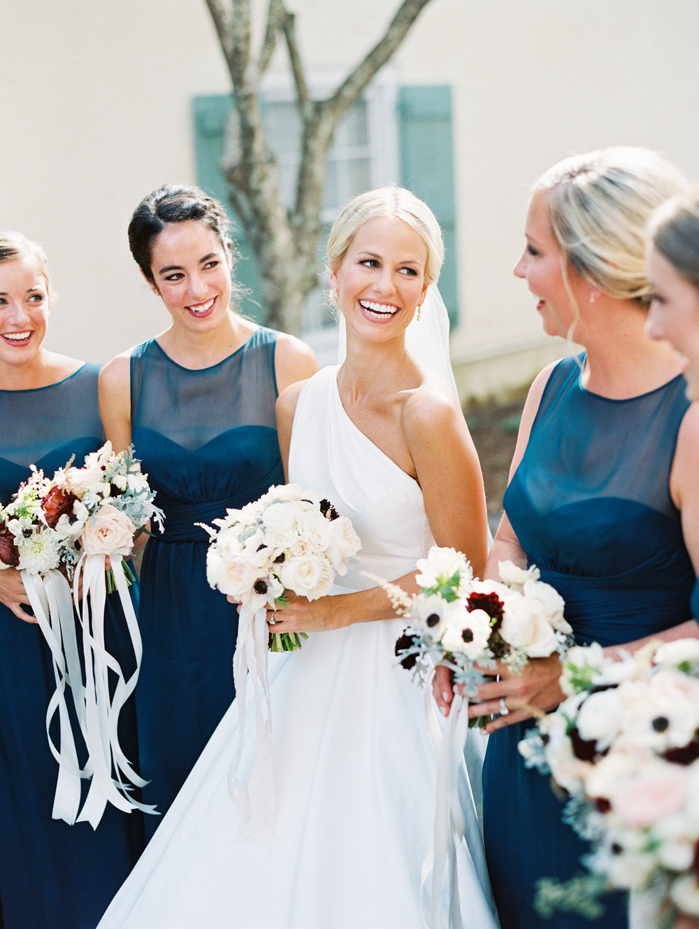 Bridesmaids in Ocean teal Amsale gowns for wedding in Charleston SC  //  Wedding photography by Landon Jacob  //  A Lowcountry Wedding Magazine