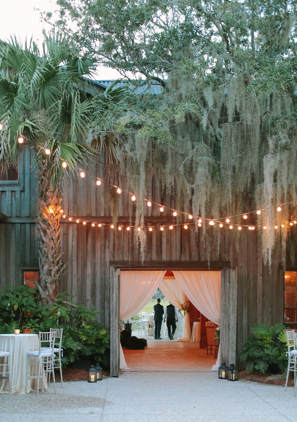 Evening wedding reception at Boone Hall Plantation's Cotton Dock  //  Wedding photography by Landon Jacob  //  A Lowcountry Wedding Magazine