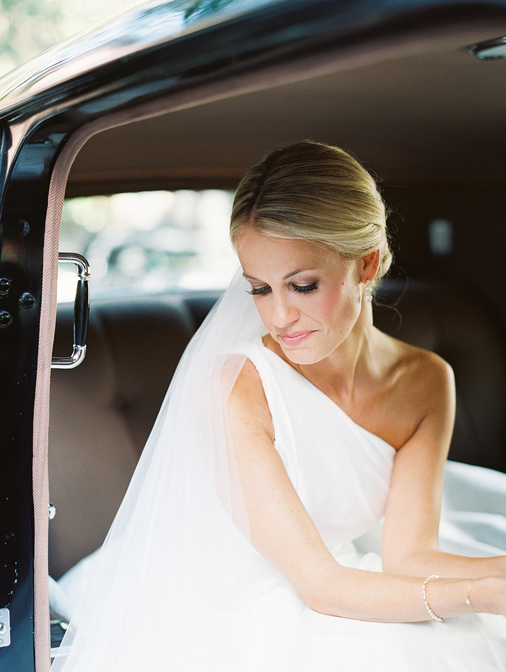 Charleston bride in a one-shouldered Romona Keveza gown  //  Wedding photography by Landon Jacob  //  A Lowcountry Wedding Magazine