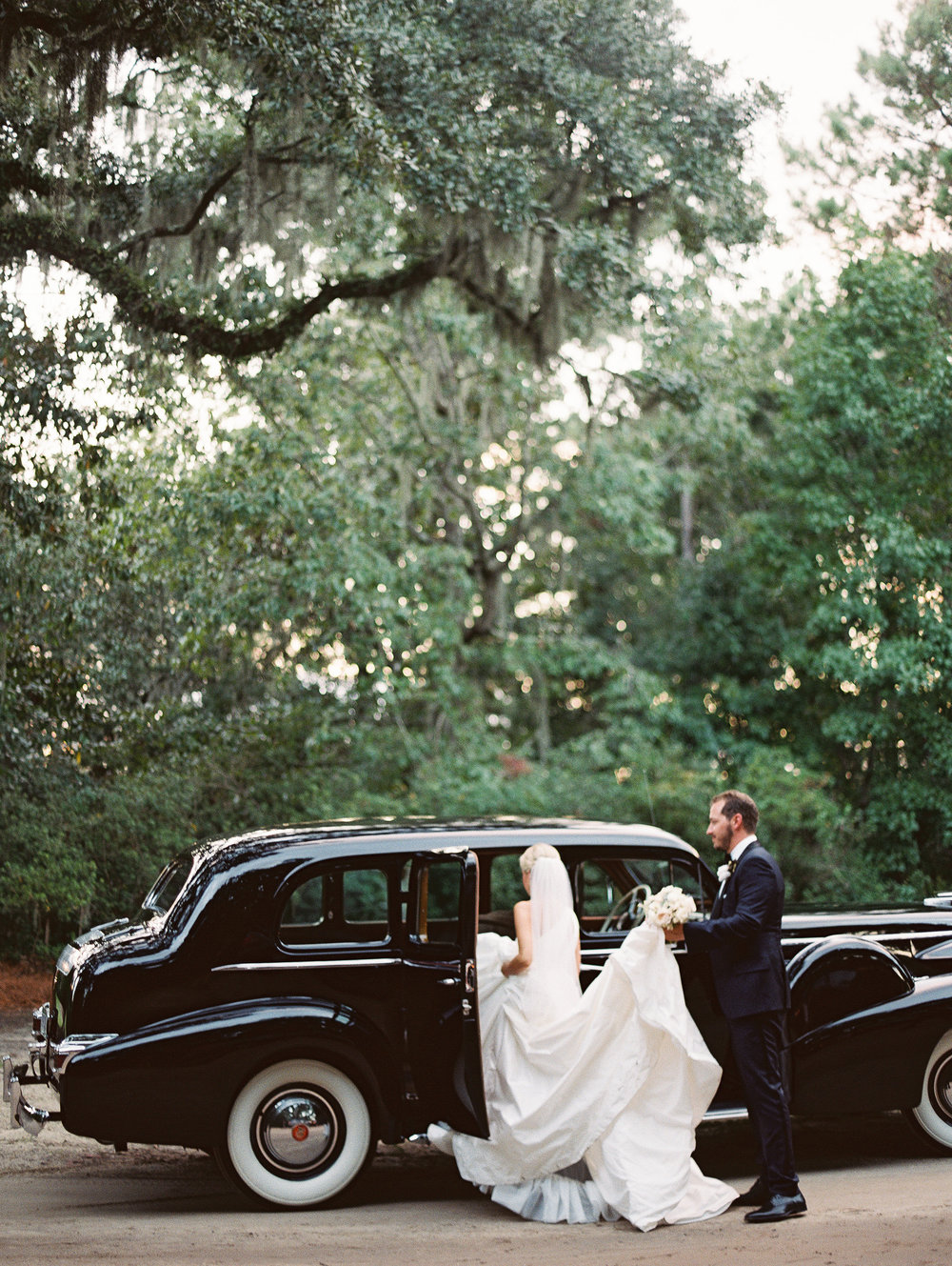 Vintage black Rolls Royce at wedding in Boone Hall Plantation  //  Wedding photography by Landon Jacob  //  A Lowcountry Wedding Magazine