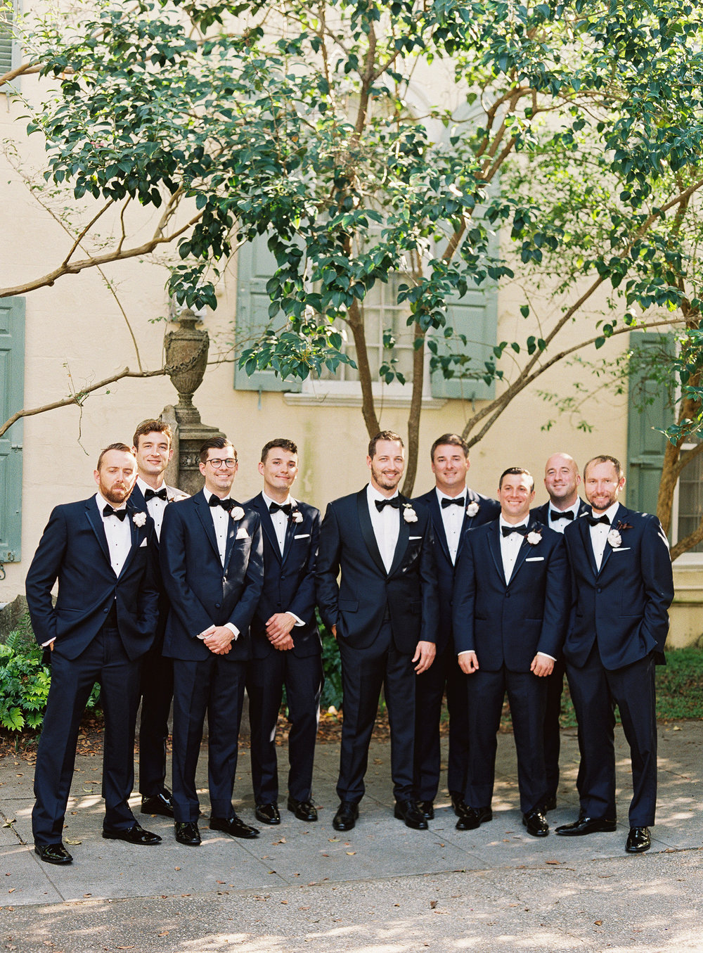 Groomsmen in navy tuxedos at wedding in Charleston SC  //  Wedding photography by Landon Jacob  //  A Lowcountry Wedding Magazine