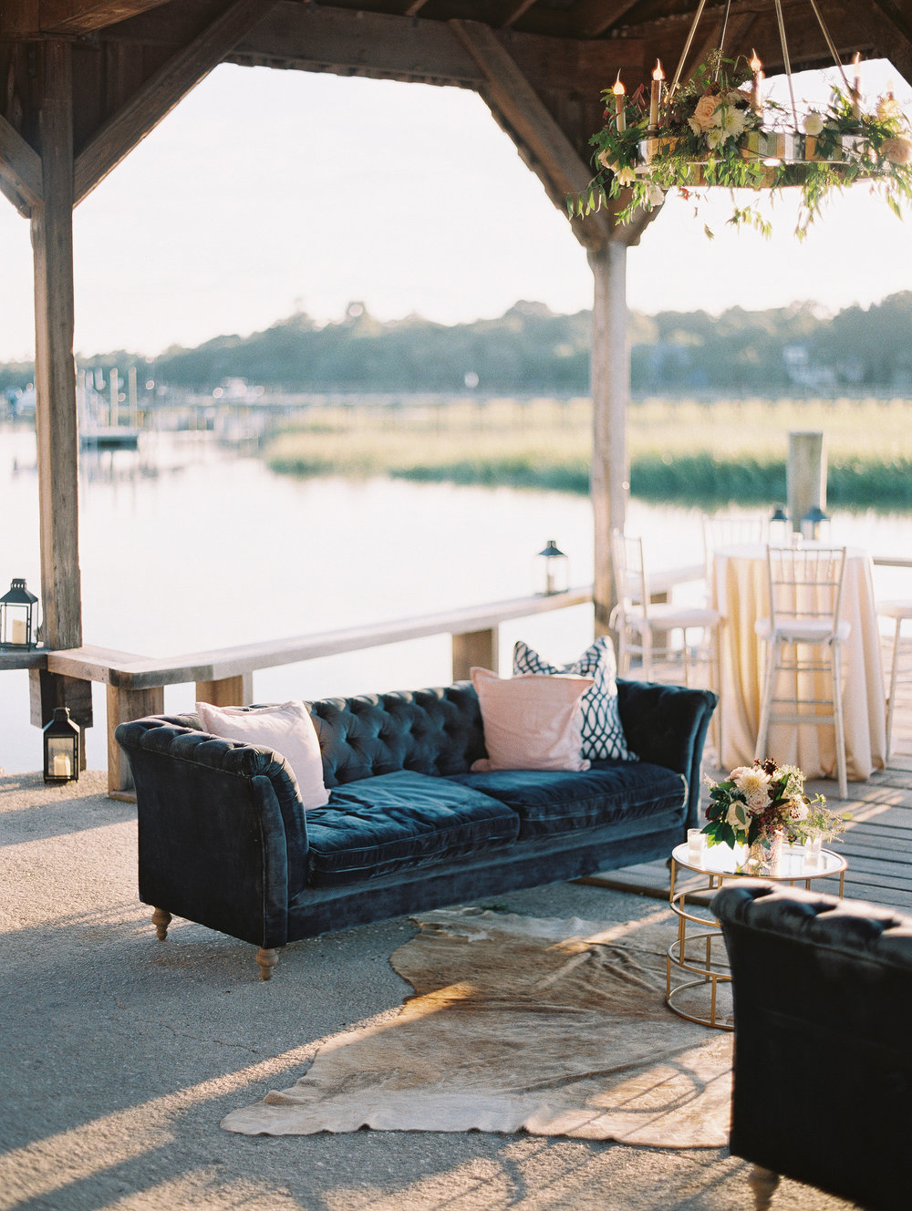 Vintage lounge setup on The Cotton Dock at Boone Hall Plantation  //  Wedding photography by Landon Jacob  //  A Lowcountry Wedding Magazine