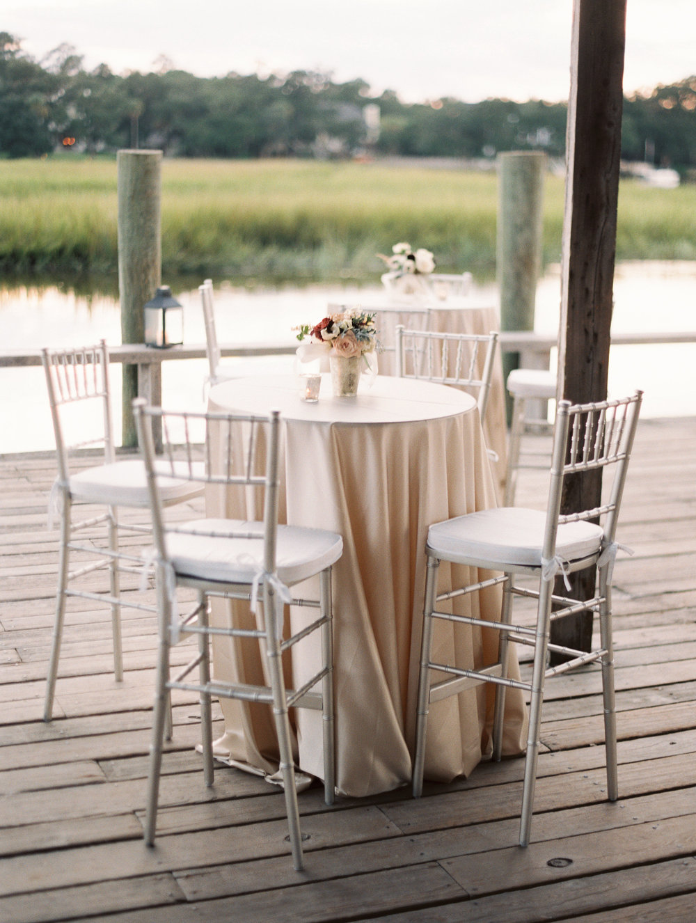 Outdoor wedding reception at Boone Hall Plantation's Cotton Dock  //  Wedding photography by Landon Jacob  //  A Lowcountry Wedding Magazine