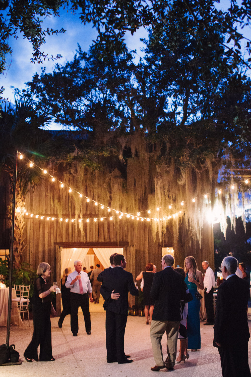 Outdoor wedding reception at The Cotton Dock in Charleston SC  //  photographed by Landon Jacob  //  A Lowcountry Wedding Magazine