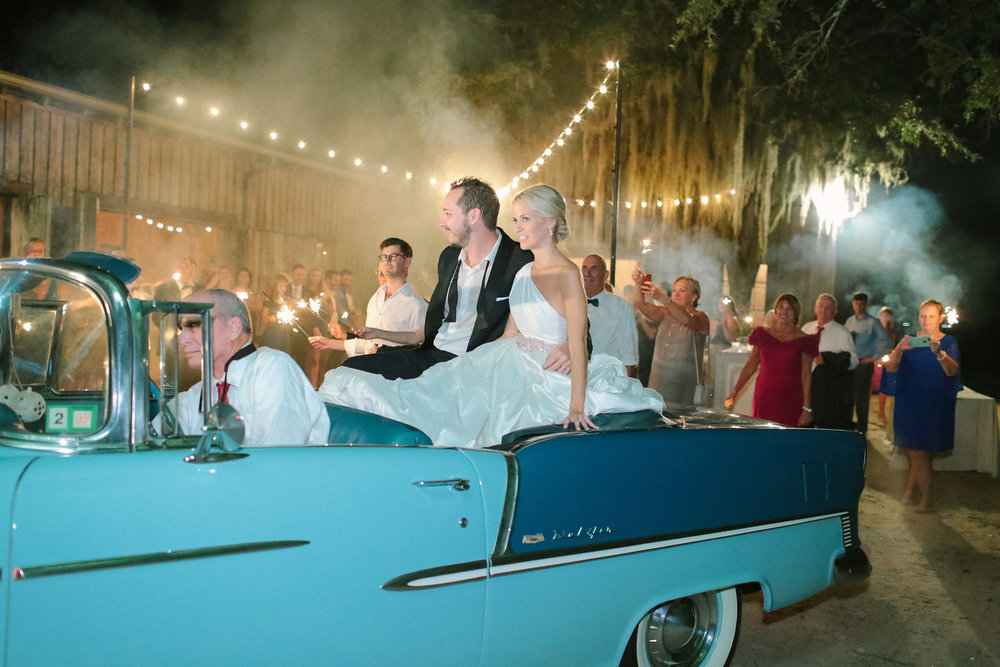 Charleston Bride & Groom depart The Cotton Dock in a vintage Bel-Air //  photographed by Landon Jacob  //  A Lowcountry Wedding Magazine