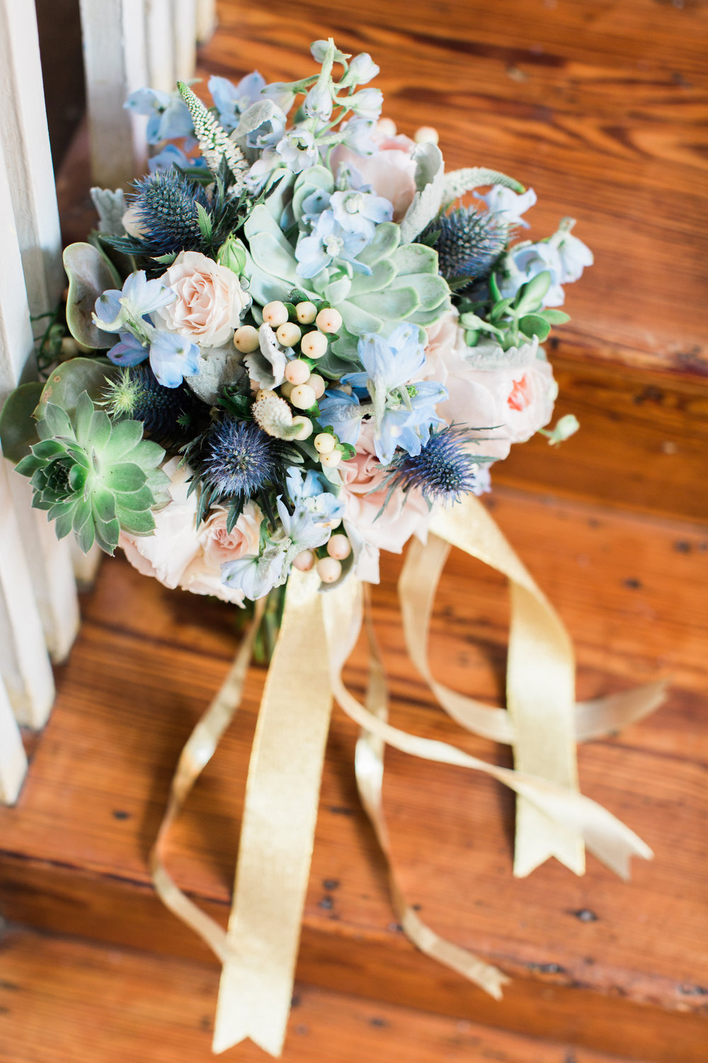Blue thistle, succulents and peach rose bouquet by Urban Poppy  //  A Lowcountry Wedding Magazine
