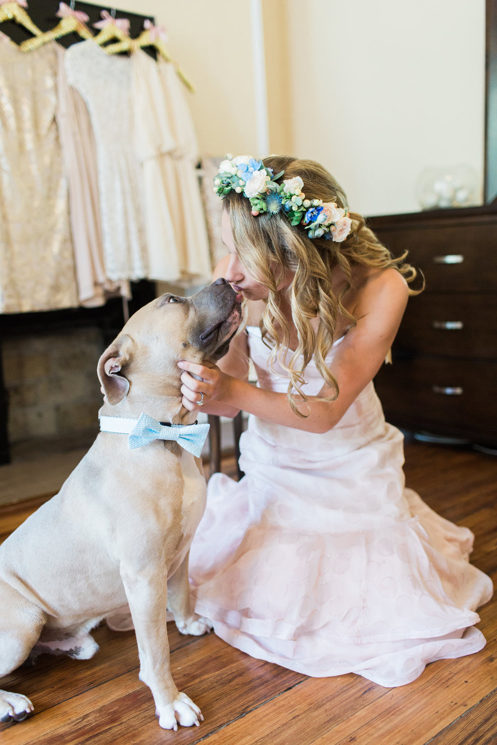 Savannah Bride kissing her dog wearing a bow tie  // wedding photos by Apt B Photography  //  A Lowcountry Wedding Magazine