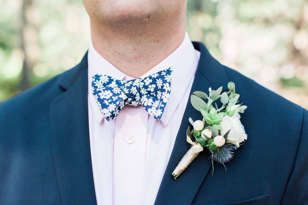 Savannah Groom wearing a blue patterned bow tie and bow tie  //  A Lowcountry Wedding Magazine