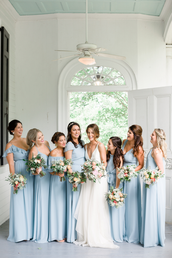 Bridesmaids in long flowing light blue dresses for Thomas Bennett House wedding  //  Charleston photography by JoPhotos