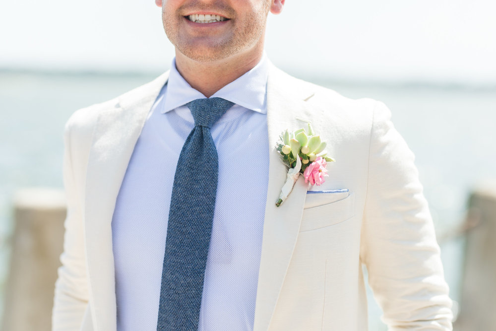 Groom in coastal attire with light blue shirt and dark blue tie  //  Hilton Head wedding photos by Garter + Whiskey