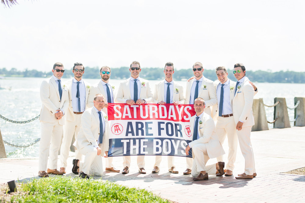 Groomsmen with Saturdays are for the Boys flag  //  A Lowcountry Wedding Magaizne