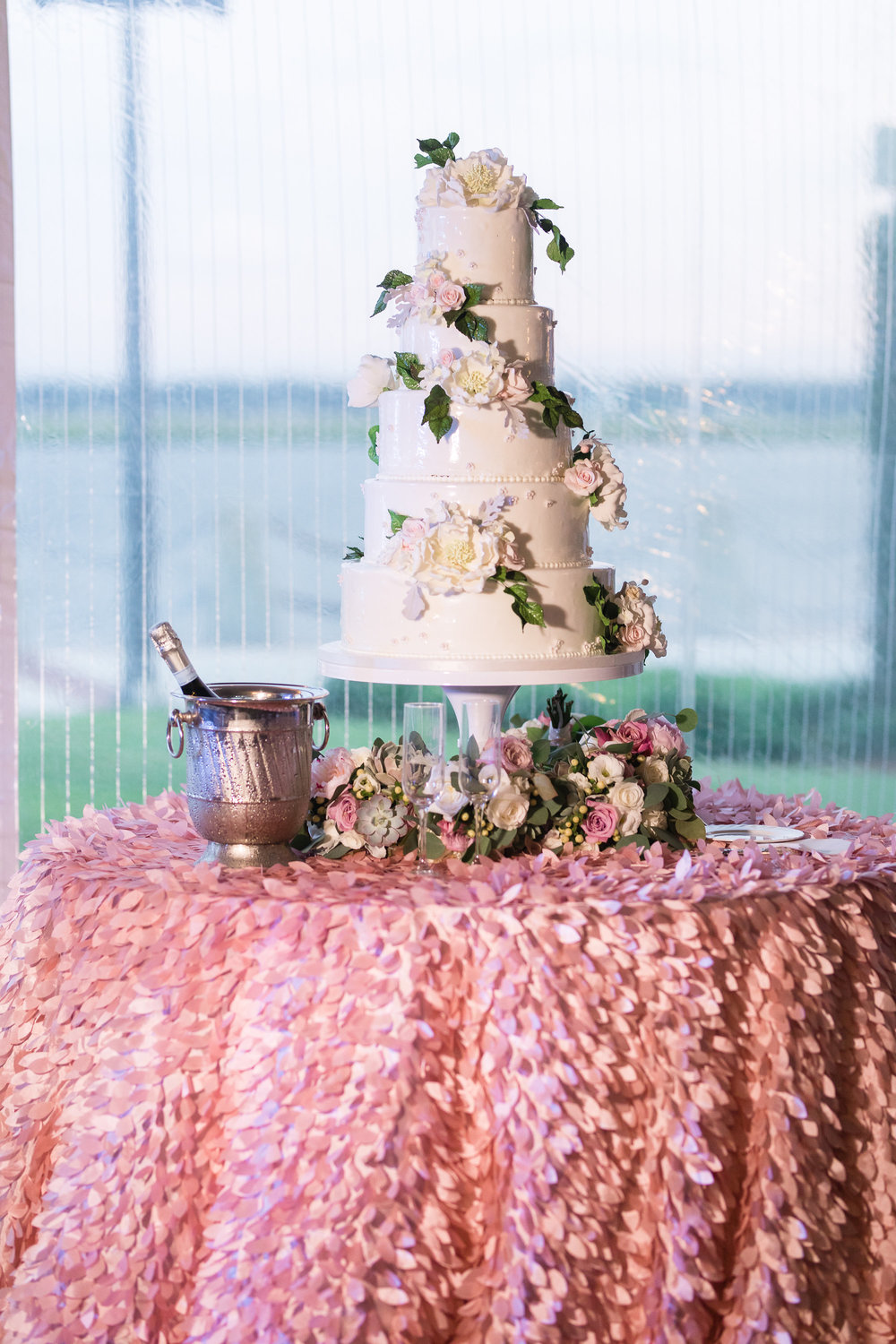 Five-tiered white cake with sugar flowers by Savannah Custom Cakes  //  A Lowcountry Wedding Magazine