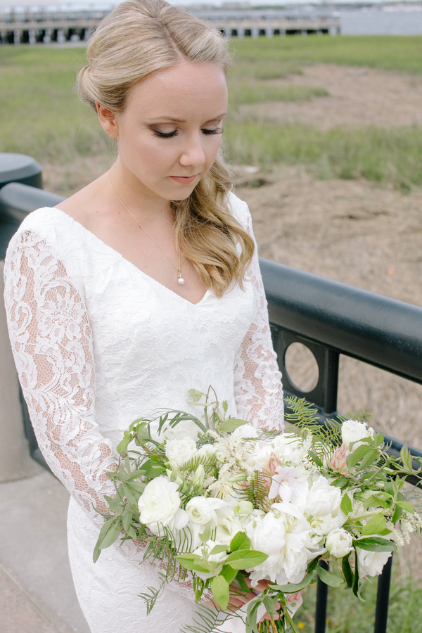Charleston bride at winter wedding with all white blooms  //  A Lowcountry Wedding Magazine