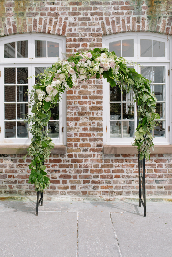 Floral ceremony arch at the Historic Rice Mill Building by Branch Design Studio  //  Charleston wedding photos by Riverland Studios