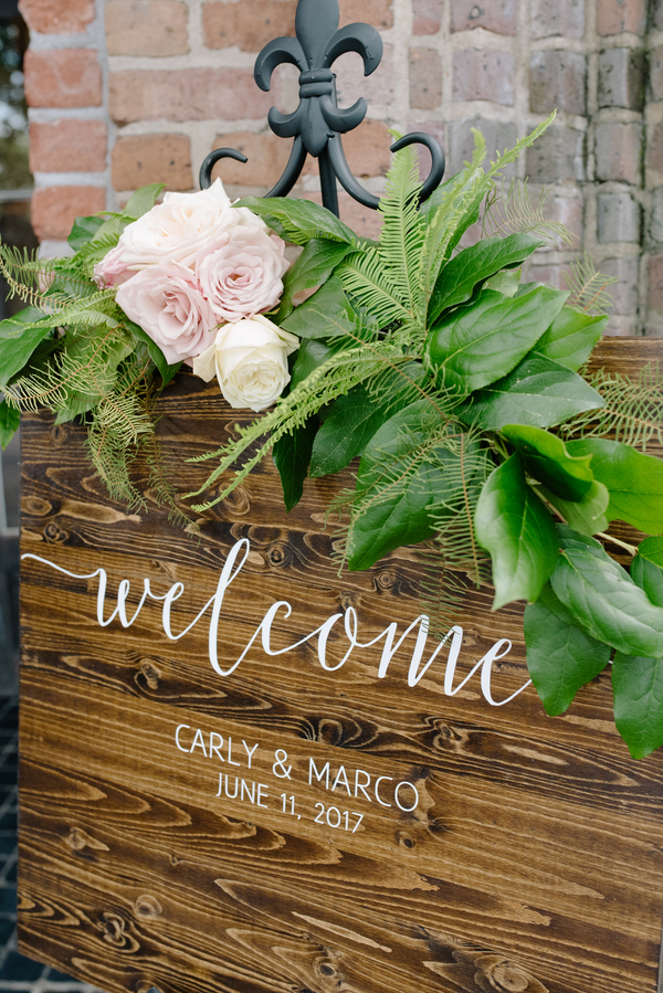 Ceremony welcome sign at the Rice Mill Building  //  Charleston wedding photos by Riverland Studios