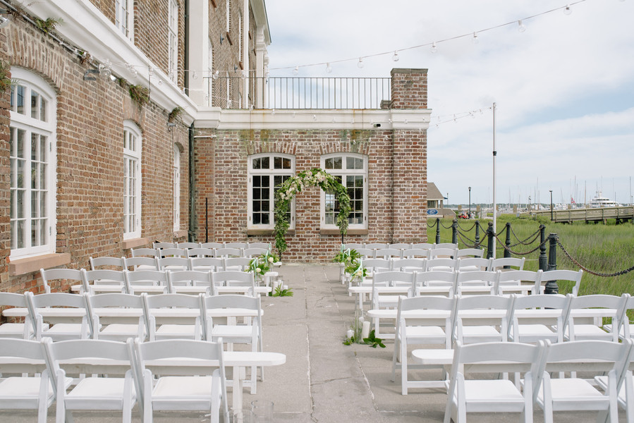 Outdoor ceremony at The Historic Rice Mill Building   //  Charleston wedding photos by Riverland Studios