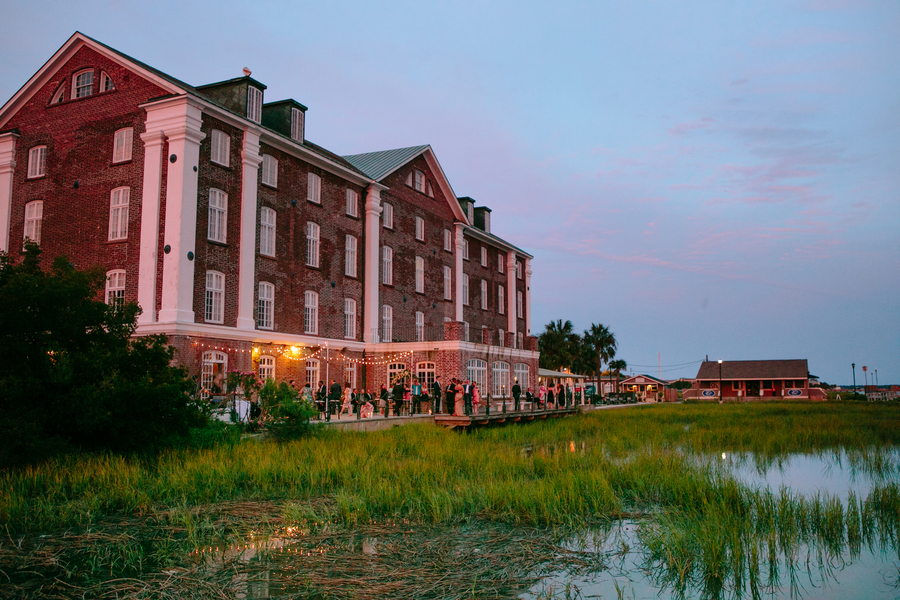 Evening wedding reception at The Historic Rice Mill Building by Riverland Studios