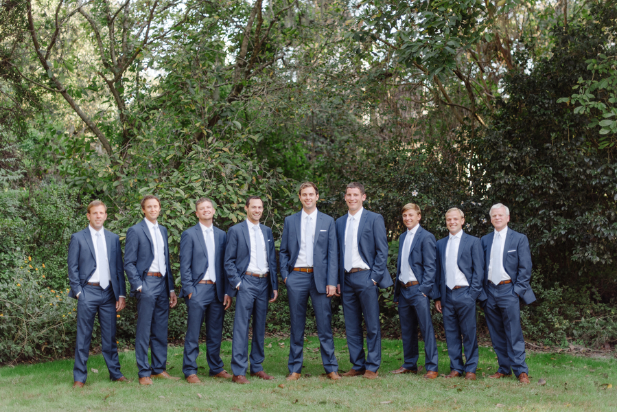 Groomsmen in navy suits at Magnolia Plantation and Gardens wedding