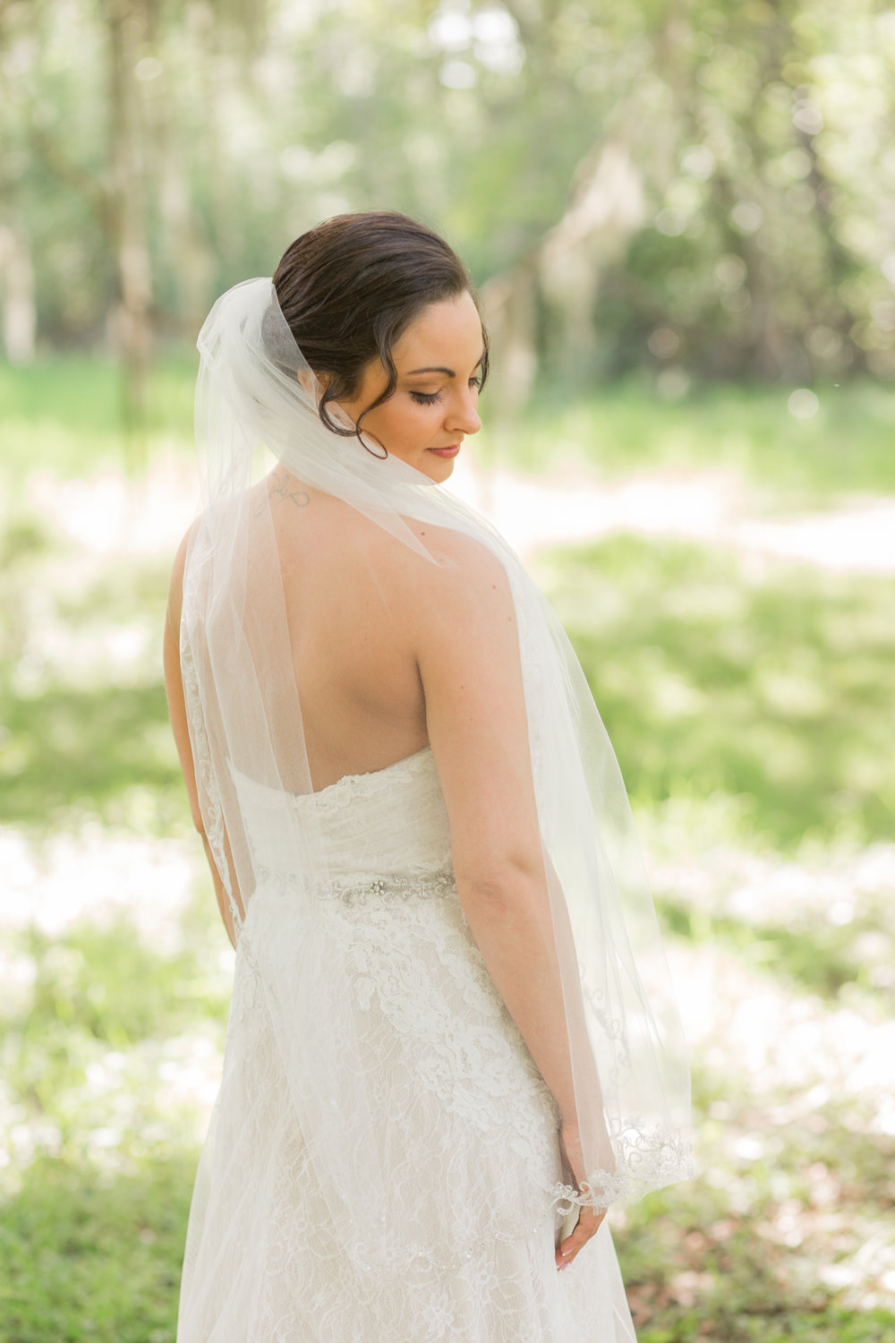 Savannah bride in a lace wedding gown from Ivory + Beau  //  A Lowcountry Wedding Magazine