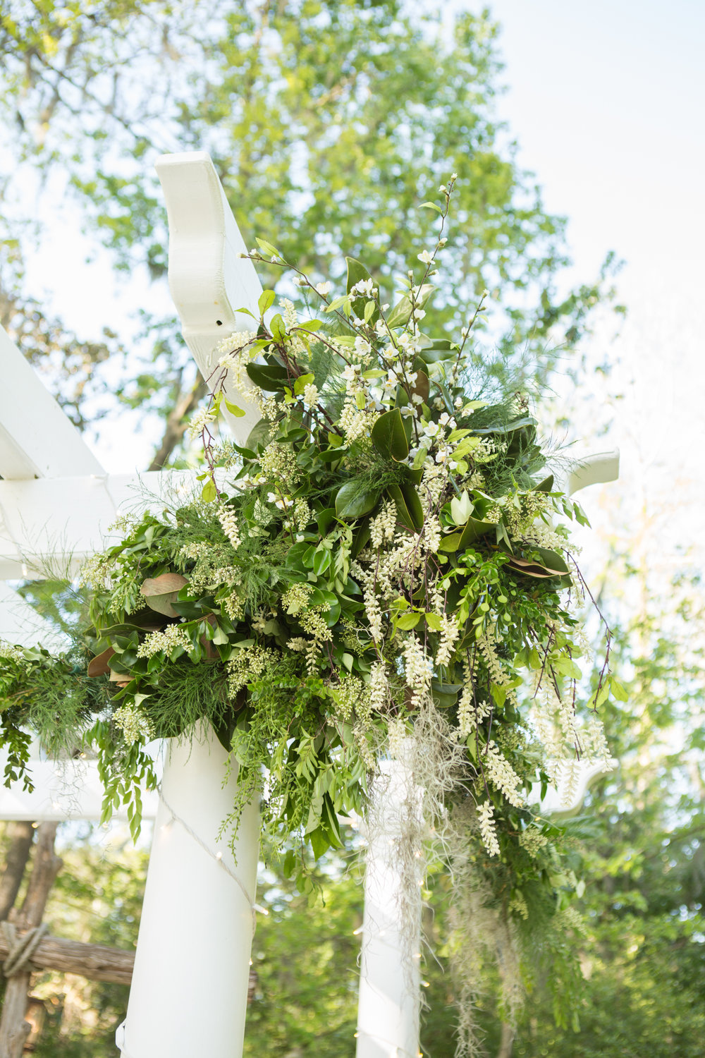 Spring floral arbor for wedding ceremony at The Mackey House