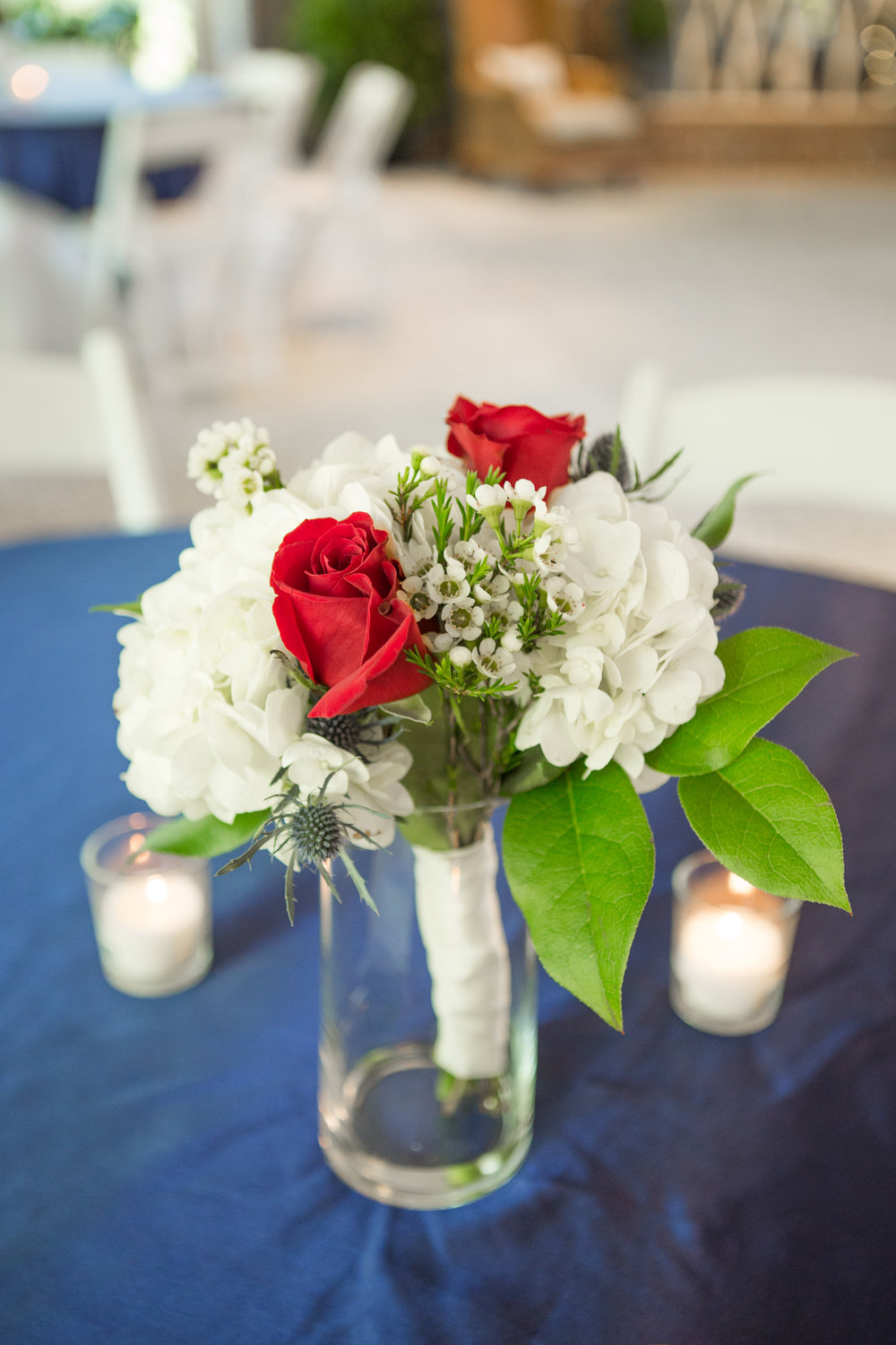 Red and white bouquets by John Davis Florist at Savannah Military Wedding