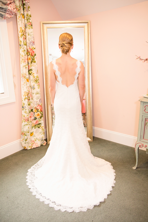 bride-in-lace-dress-looking-in-mirror.jpg