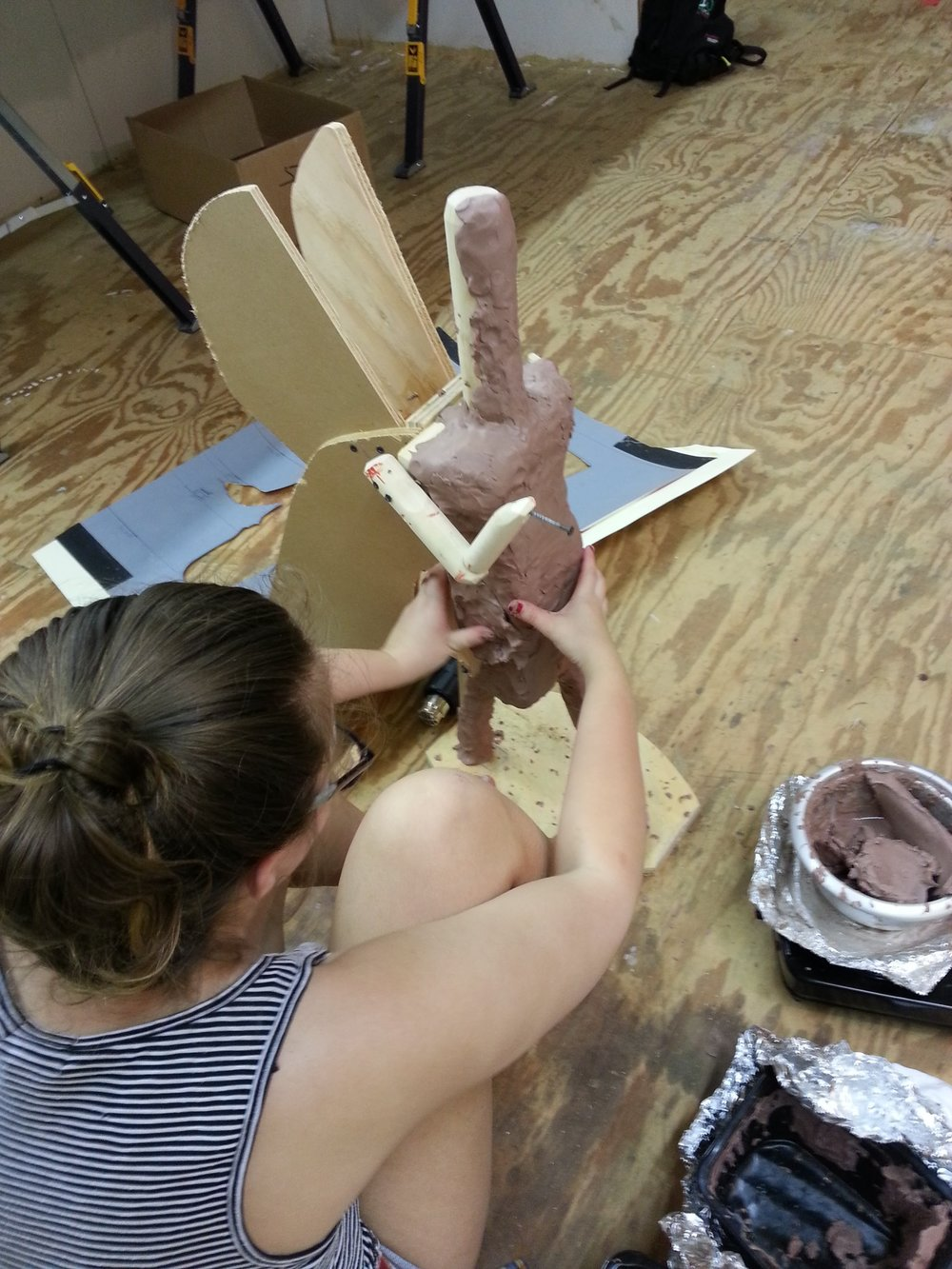 adding clay to the skelaton