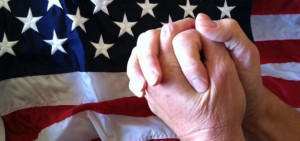 Praying_hands_in_front_of_American_flag