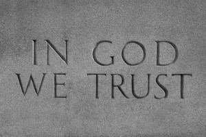 """Famous saying, In God We Trust, carved in stone."""