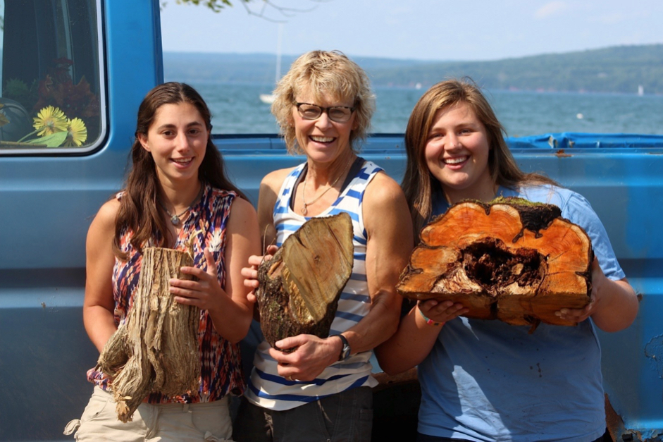Pictured left to right: Brigid Reina holding largest honeysuckle stump (found on Chief Buffalo Ln), Bonnie Matuseski holding second largest buckthorn stump (found on Mission Hill), Rebecca Flesh holding half of largest buckthorn stump (found near Grant's Point)