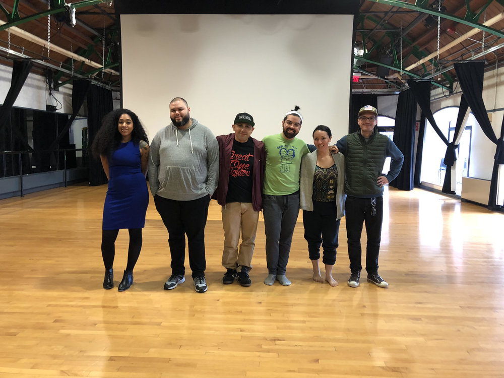 "6x6 ""The Power of Play"" panelists pose for a group photo after their 6-minute presentations about the value of play in their creative process and work with youth in Ashamu Dance Theater at Brown University. From left to right: Anjel Newmann, Aneudy Alba, Pierre Arreola, Matthew Garza, Michele Baer, and Javier Nunez."
