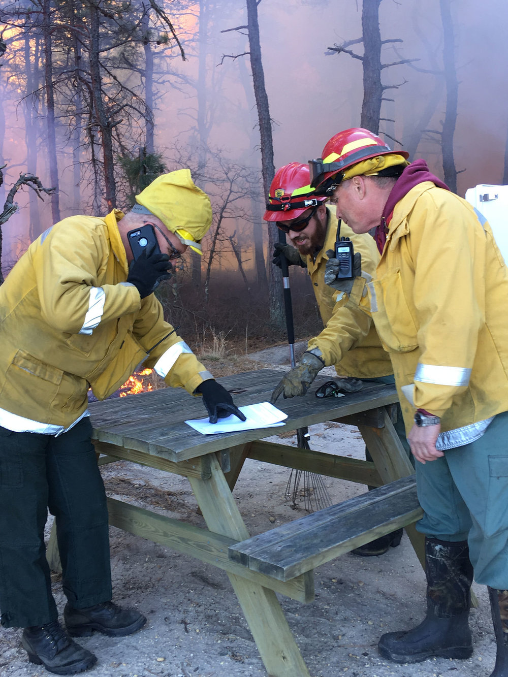 Tom Gerber, NAFSE Community Representative, at right, on a research burn in New Jersey's pinelands. Photo by Nick Skowronski.